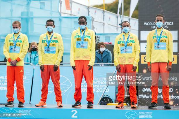 Secon dplaced team of Ethiopia Amedework Walelegn Andamlak Belihu Leus Gebresilase Hailemaryam Kiros Guye Idemo Adola celebrate on the podium after...