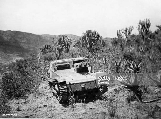 Second Abyssinian War April 1935 A Carro Veloce 33 tankette of the Italian army forcing a passage through the trackless and difficult country that...
