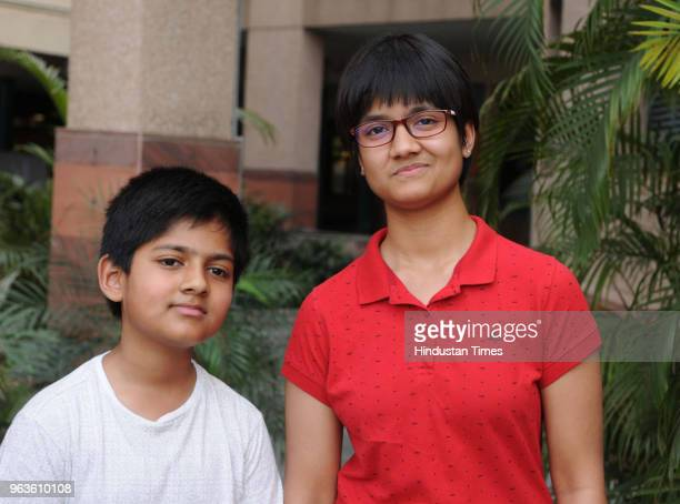 Second All India topper Writika celebrate pose for a picture with her younger brother after Central Board of Secondary Education declared class 10th...