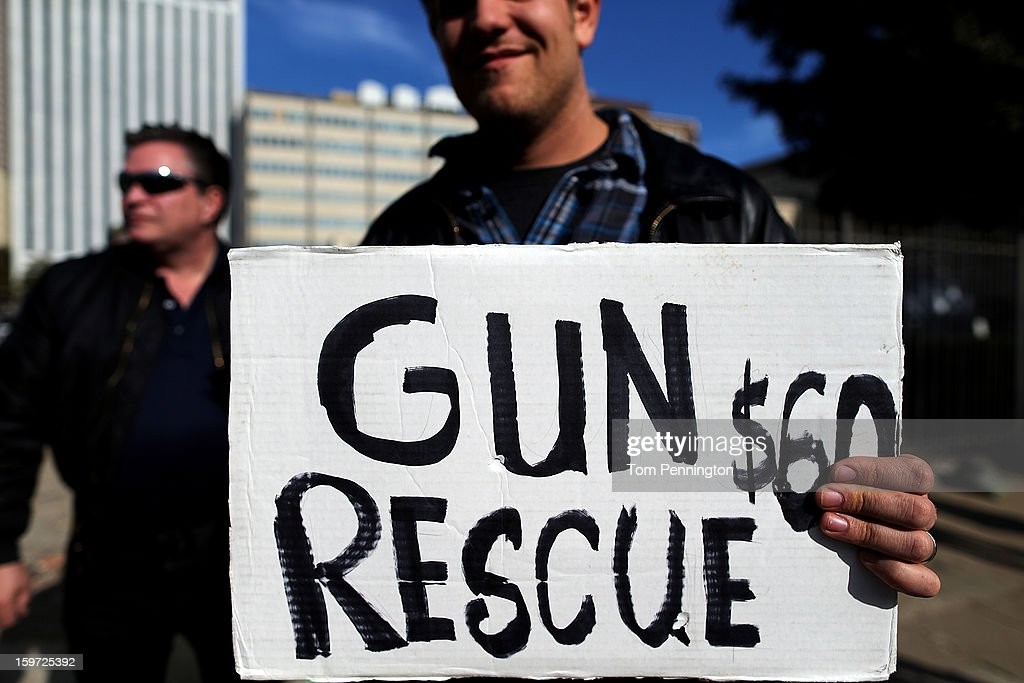 A Second Amendment supporter and gun enthusiast displays a sign across the street from a gun buy back program at the First Presbyterian Church of Dallas on January 19, 2013 in Dallas, Texas. U.S. President Barack Obama recently unveiled a package of gun control proposals that include universal background checks and bans on assault weapons and high-capacity magazines.