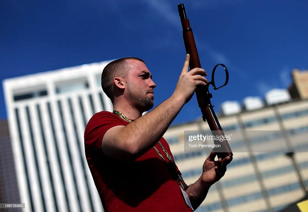 Second Amendment supporter and gun enthusiast Shade Haddox displays an unloaded rifle that was being sold in an impromptu auction across the street from a gun buy back program at the First Presbyterian Church of Dallas on January 19, 2013 in Dallas, Texas. U.S. President Barack Obama recently unveiled a package of gun control proposals that include universal background checks and bans on assault weapons and high-capacity magazines.