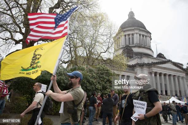 Second amendment supporters protest outside the Washington State Capitol building during a March For Our Rights progun rally on April 21 2018 in...