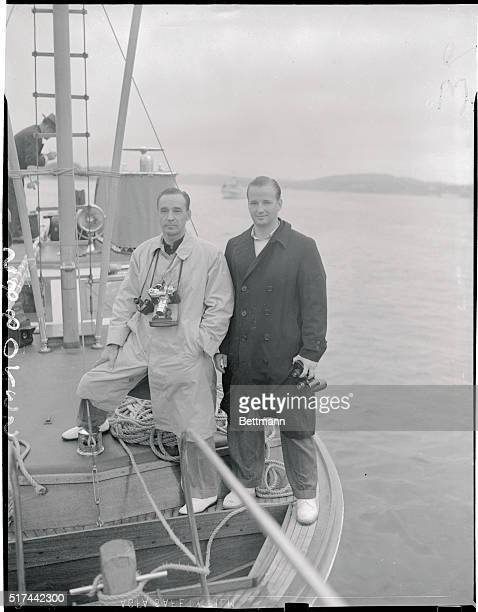 Second and Third Generation Fords at Yale-Harvard Race. New London, Connecticut: Edsel Ford, automobile magnate, and his son Benson, pictured as they...