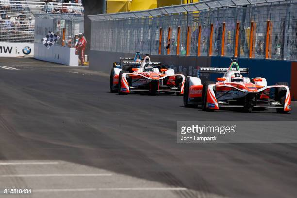 Second and third place winners Nick Heidfeld and Felix Rosenqvist of Machindra Racing on track during Formula E Qualcomm New York City ePri on July...