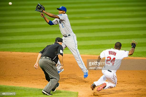 Second base umpire Eric Cooper watches as Michael Bourn of the Cleveland Indians is safe at second on a stolen base as second baseman Alcides Escobar...