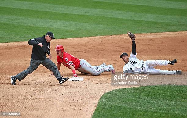 Second base umpire Jerry Meals calls Mike Trout of the Los Angeles Angels out after a tag by Tyler Saladino of the Chicago White Sox in the 9th...