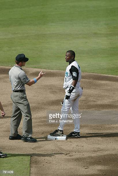 Second Base umpire Jim Wolf explains the call to second baseman Luis Castillo of the Florida Marlins after second baseman Brent Abernathy of the...