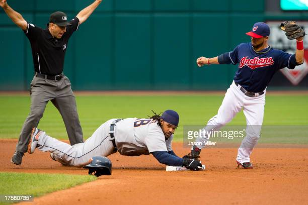 Second base umpire Phil Cuzzi calls Prince Fielder of the Detroit Tigers safe at second on a hit to right as second baseman Mike Aviles of the...