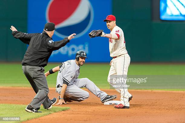 Second base umpire Todd Tichenor calls Jordan Danks of the Chicago White Sox safe at second as second baseman Jason Kipnis of the Cleveland Indians...