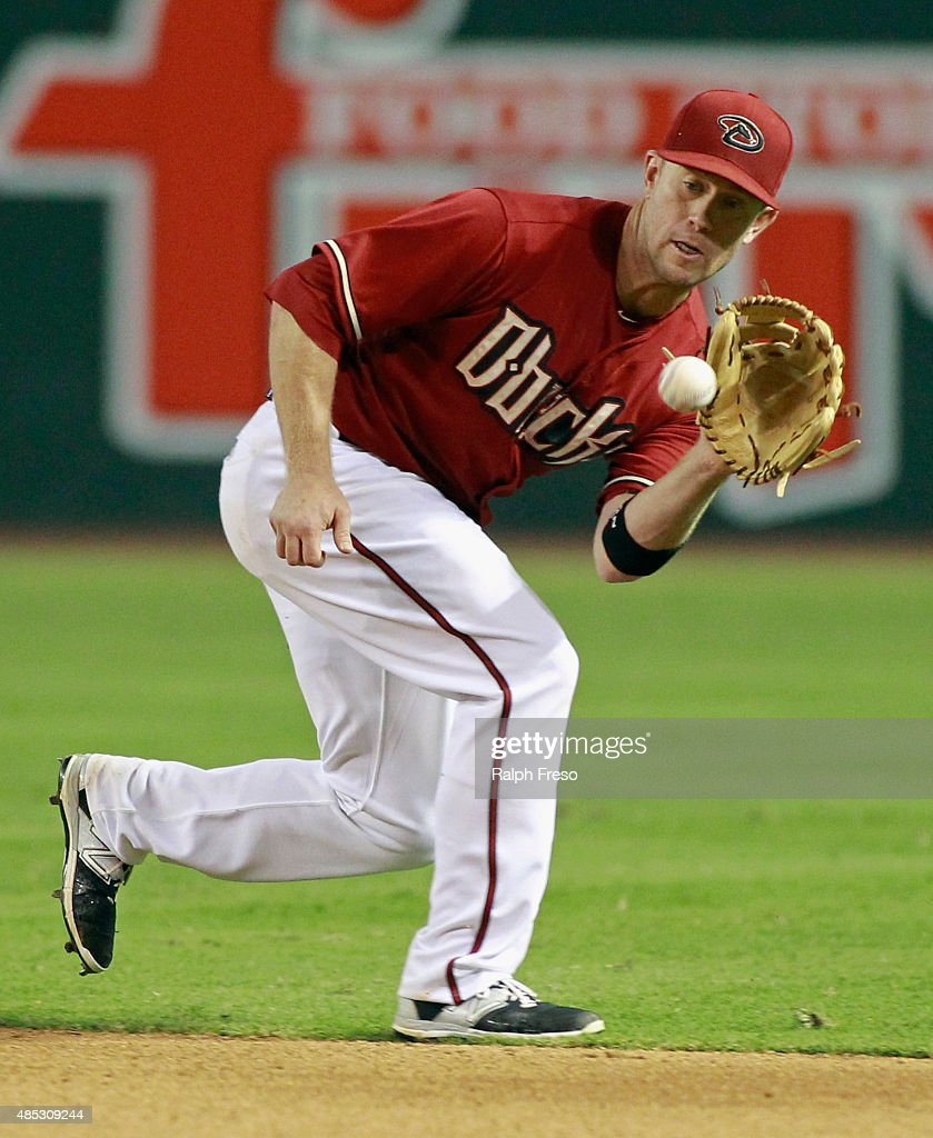 Second baseman Aaron Hill #2 of the Arizona Diamondbacks fields a ground ball for an out against the St Louis Cardinals during the ninth inning of a MLB game at Chase Field on August 26, 2015 in Phoenix, Arizona. The Cardinals defeated the Diamondbacks 3-1.