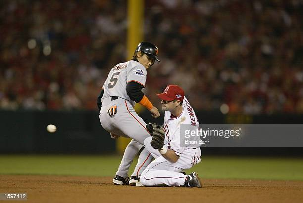 Second Baseman Adam Kennedy of the Anaheim Angels attempts to tag out center fielder Tsuyoshi Shinjo of the San Francisco Giants during game one of...