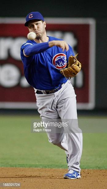 Second baseman Adrian Cardenas of the Chicago Cubs throws to first base on a ground ball out against the Arizona Diamondbacks during a MLB game at...