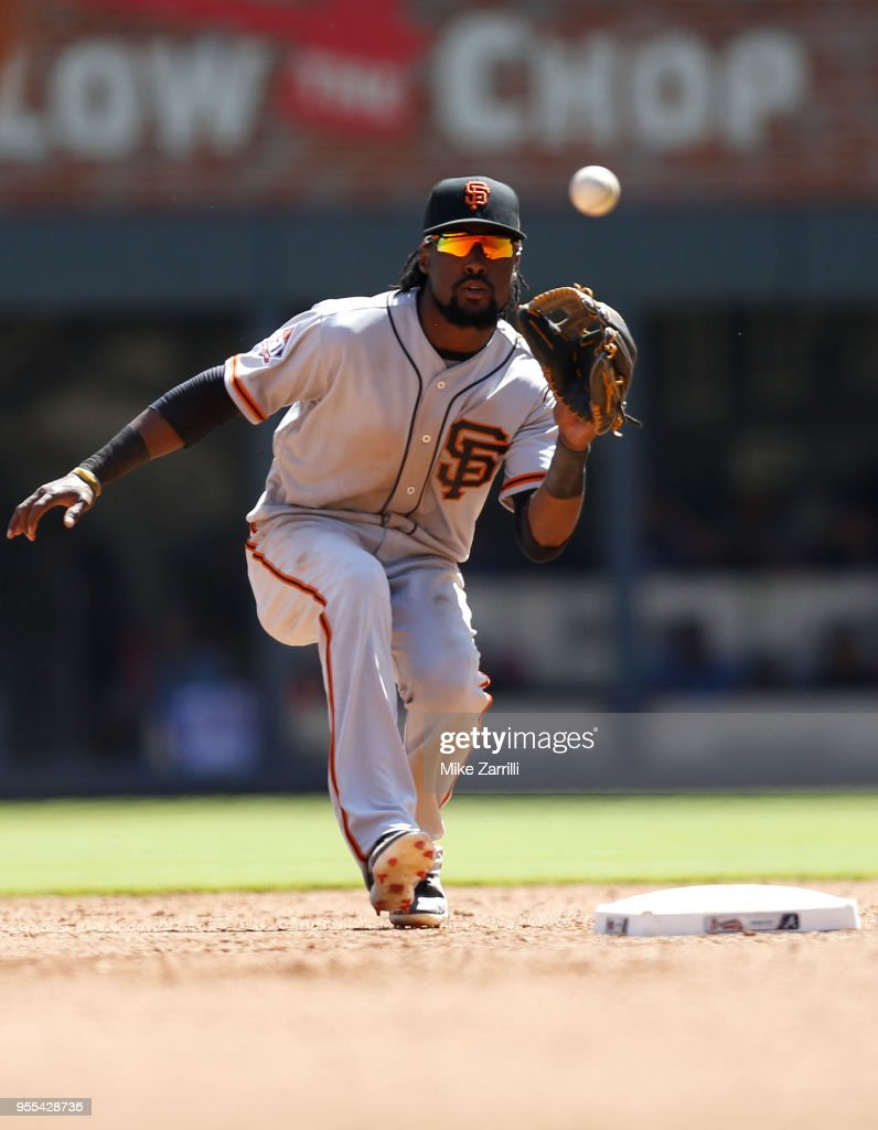 Second baseman Alen Hanson #19 of the San Francisco Giants makes a force play at second base in the sixth inning during the game against the Atlanta Braves at SunTrust Park on May 6, 2018 in Atlanta, Georgia.