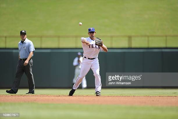 Second baseman Alex Cora of the Texas Rangers fields his position as he throws to first base after catching a ground ball during the game against the...