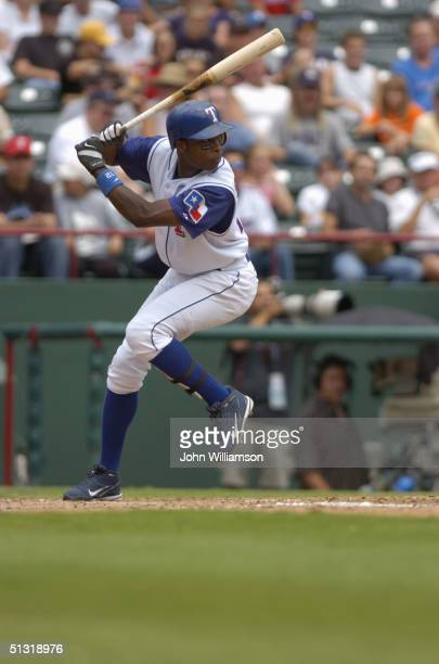 Second baseman Alfonso Soriano of the Texas Rangers bats during the MLB game against the Tampa Bay Devil Rays at Ameriquest Field in Arlington on...