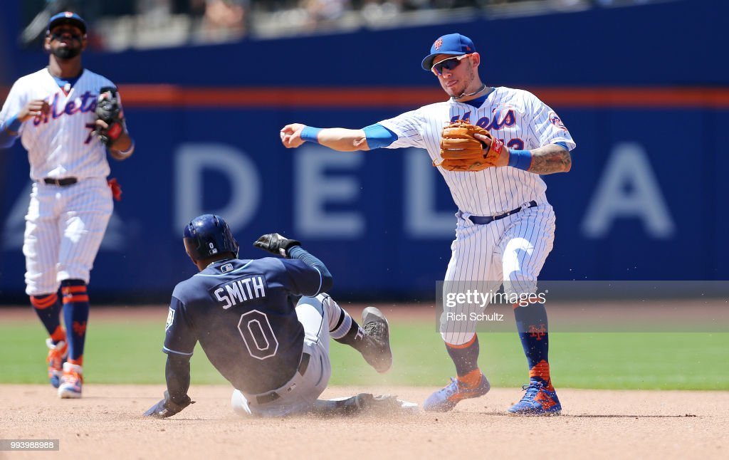 Second baseman Asdrubal Cabrera #13 of the New York Mets gets the force on Mallex Smith #0 of the Tampa Bay Rays and throws to first base to get Jesus Sucre #45 to complete a double play during the fifth inning of a game at Citi Field on July 8, 2018 in the Flushing neighborhood of the Queens borough of New York City.
