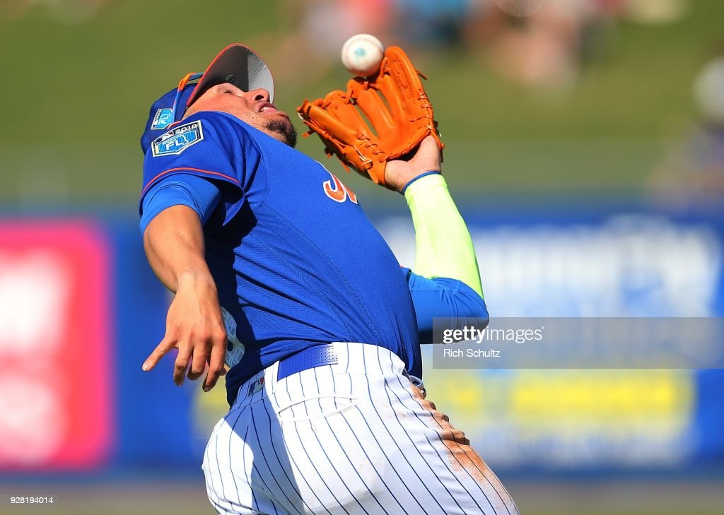 Second baseman Asdrubal Cabrera #13 of the New York Mets makes an over the shoulder catch on a fly ball hit by J.D. Davis #28 of the Houston Astros during the 6th inning of a spring training game at First Data Field on March 6, 2018 in Port St. Lucie, Florida. The Mets defeated the Astros 9-5.
