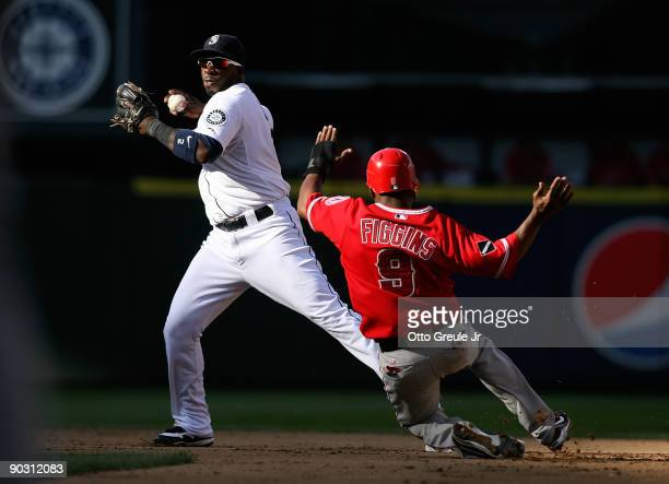 Second baseman Bill Hall of the Seattle Mariners takes the throw as Chone Figgins of the Los Angeles Angels of Anaheim is out on a fielders choice on...