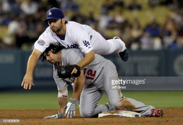 Second baseman Blake DeWitt of the Los Angeles Dodgers falls over Aaron Miles of the St. Louis Cardinals after Miles was forced out at second base in...
