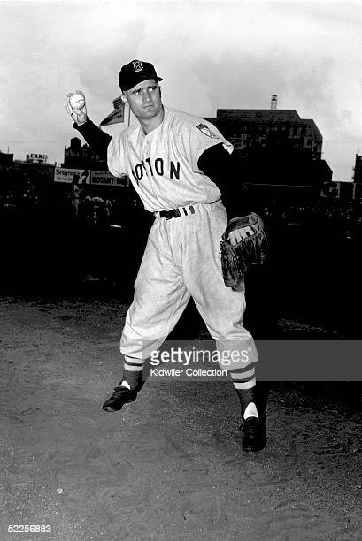Second baseman Bobby Doerr of the Boston Red Sox poses for an action portrait before a 1951 game against the New York Yankees at Yankee Stadium in...