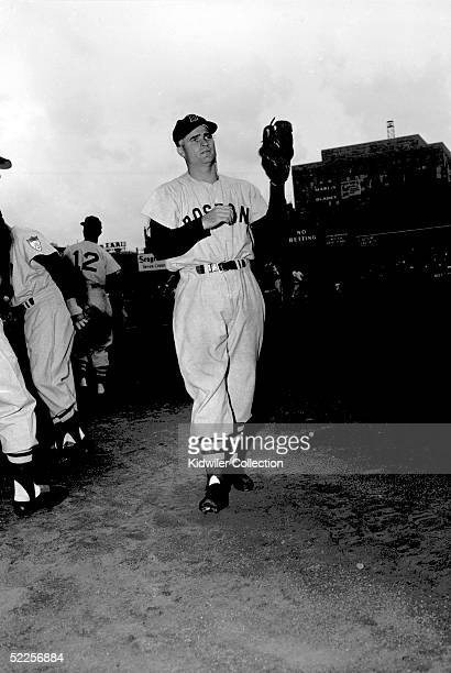 Second baseman Bobby Doerr of the Boston Red Sox warms up prior to a 1951 game against the New York Yankees at Yankee Stadium in the Bronx New York...