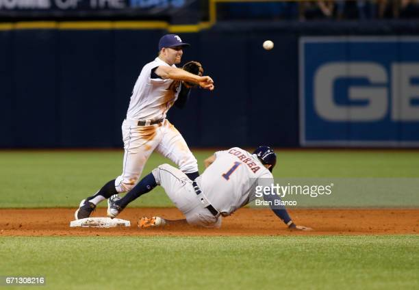 Second baseman Brad Miller of the Tampa Bay Rays gets the forced out at secon base on Carlos Correa of the Houston Astros then turns the double play...