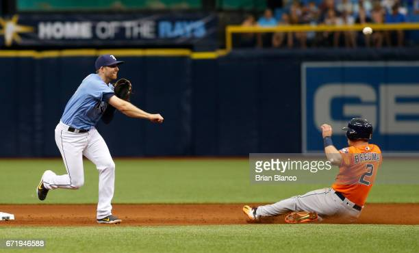 Second baseman Brad Miller of the Tampa Bay Rays gets the forced out on Alex Bregman of the Houston Astros at second base then turns the double play...