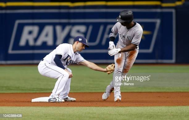Second baseman Brandon Lowe of the Tampa Bay Rays catches Andrew McCutchen of the New York Yankees attempting to steal second base to end the top of...