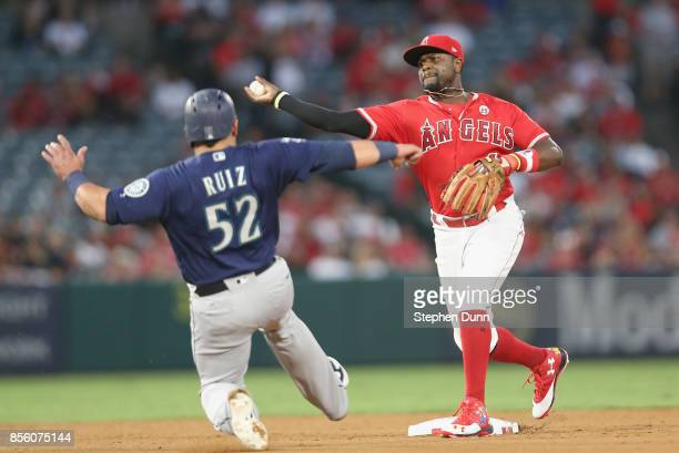 Second baseman Brandon Phillips of the Los Angeles Angels of Anaheim throws to first to complete a double play after forcing out Carlos Ruiz of the...