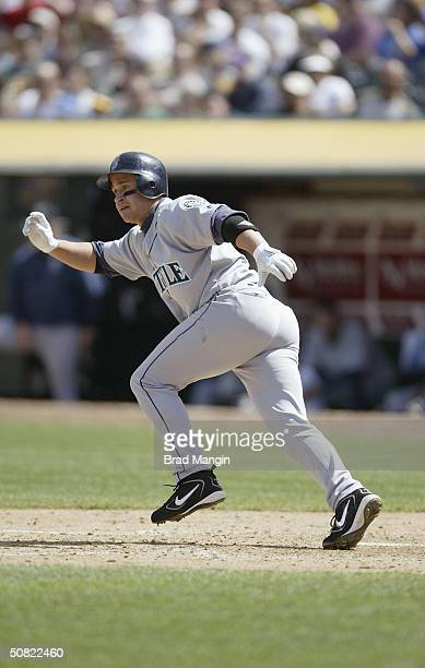 Second baseman Bret Boone of the Seattle Mariners runs to first base during the game against the Oakland Athletics at Network Associates Coliseum on...