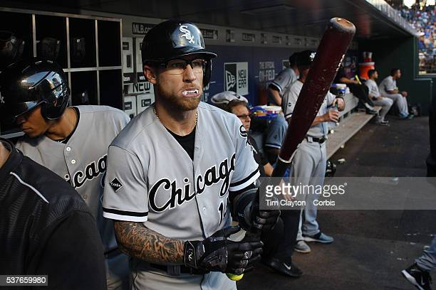 Second baseman Brett Lawrie of the Chicago White Sox preparing to bat in the dugout wearing his white mouth guard which makes it look like he has...
