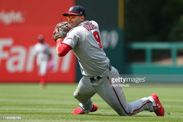 Second baseman Brian Dozier of the Washington Nationals throws out Adam Haseley of the Philadelphia Phillies from his knees in the seventh inning...