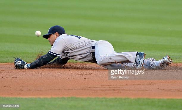 Second baseman Brian Roberts of the New York Yankees dives for but cannot catch a single hit by Adam Eaton of the Chicago White Sox during the first...