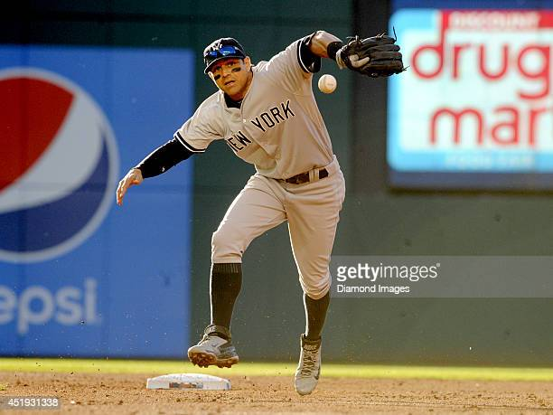 Second baseman Brian Roberts of the New York Yankees misplays a ball during a game against the Cleveland Indians on July 8 2014 at Progressive Field...