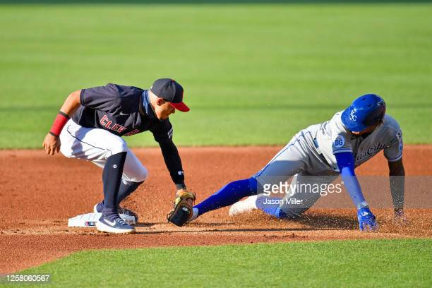 Second baseman Cesar Hernandez of the Cleveland Indians tags out Adalberto Mondesi of the Kansas City Royals on a steal attempt during the first...