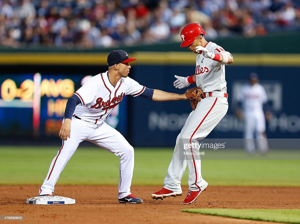Second baseman Cesar Hernandez #16 of the Philadelphia Phillies is tagged out at second base in the fifth inning by shortstop Andrelton Simmons #19 of the Atlanta Braves after Hernandez tried to stretch a single into a double during the game at Turner Field on July 3, 2015 in Atlanta, Georgia.