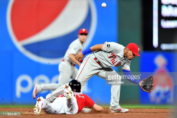Second baseman Cesar Hernandez of the Philadelphia Phillies misses the throw as Andrew Velazquez of the Cleveland Indians steals second during the...