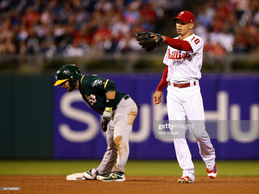 Second baseman Cesar Hernandez #16 of the Philadelphia Phillies signals for a replay on what was originally called a double on a ball hit by Jed Lowrie #8 of the Oakland Athletics during the fifth inning but reversed in a game at Citizens Bank Park on September 15, 2017 in Philadelphia, Pennsylvania.