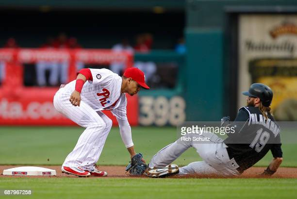 Second baseman Cesar Hernandez of the Philadelphia Phillies tags out Charlie Blackmon of the Colorado Rockies who attempted to steal during the first...