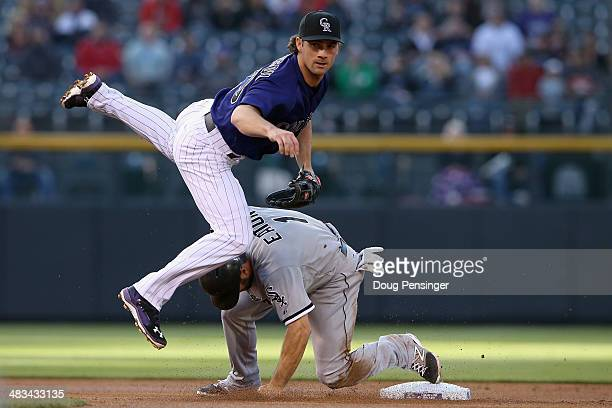 Second baseman Charlie Culberson of the Colorado Rockies avoids the slide of Adam Eaton of the Chicago White Sox and turns a double play on Marcus...