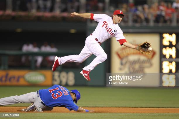 Second baseman Chase Utley of the Philadelphia Phillies avoids the slide of shortstop Starlin Castro of the Chicago Cubs during a game at Citizens...