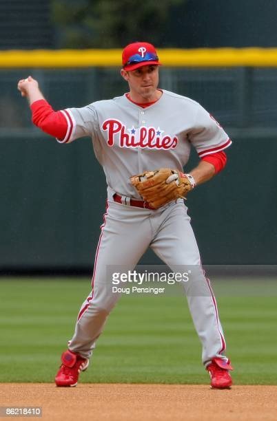 Second baseman Chase Utley of the Philadelphia Phillies plays defense against the Colorado Rockies at Coors Field on April 12 2009 in Denver Colorado...