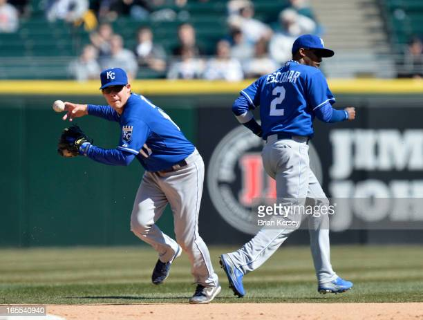 Second baseman Chris Getz of the Kansas City Royals bobbles the ball on an infield single hit by Alex Rios of the Chicago White Sox as shortstop...