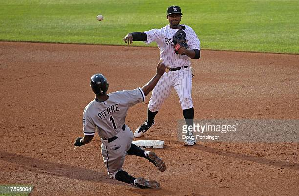 Second baseman Chris Nelson of the Colorado Rockies turns a double play on left fielder Juan Pierre of the Chicago White Sox in the third inning...