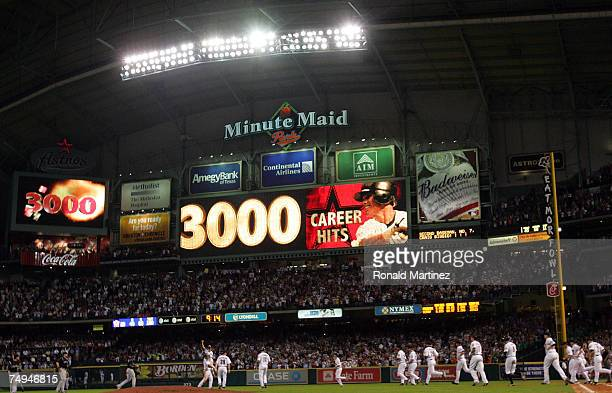 Second baseman Craig Biggio of the Houston Astros celebrates with his team after getting his 3,000th career hit against the Colorado Rockies in the...