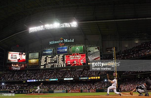 Second baseman Craig Biggio of the Houston Astros gets his 3000th career hit against the Colorado Rockies in the 7th inning on June 28 2007 at Minute...