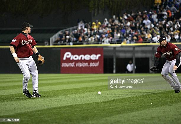 Second baseman Craig Biggio of the Houston Astros misses a fly ball that would score a run on a hit by Juan Uribe during game 2 of the 2005 World...