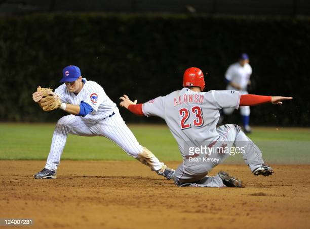 Second baseman D. J. LeMahieu of the Chicago Cubs forces out Yonder Alonso of the Cincinnati Reds at second base after Ramon Hernandez hit a line...