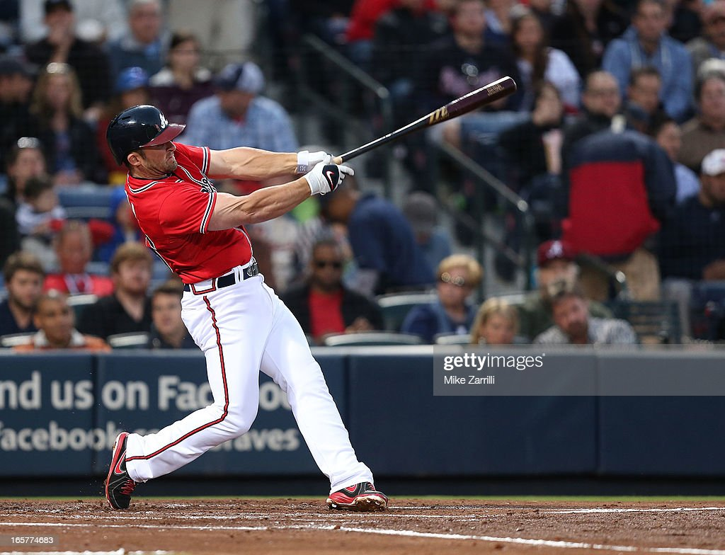 Second baseman Dan Uggla #26 of the Atlanta Braves follows through on a swing during the game against the Chicago Cubs at Turner Field on April 5, 2013 in Atlanta, Georgia.