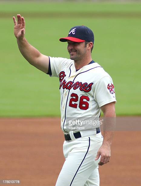 Second baseman Dan Uggla of the Atlanta Braves waves to the fans before the game against the St Louis Cardinals at Turner Field on July 27 2013 in...